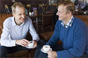 Hypnosis Downloads founders Roger Elliott and Mark Tyrrell enjoying a coffee in The Chocolate Shop, Oban.